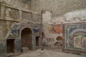 Fresco depicting gladiator battle discovered in Pompeii tavern