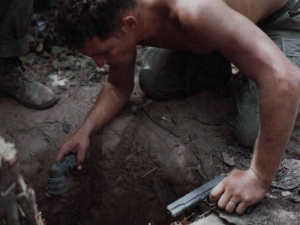 A US tunnel rat soldier prepares to enter a Viet Cong tunnel